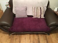 Two seater brown sofa two sofa available