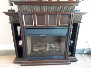 Electric fireplace with lit shelving