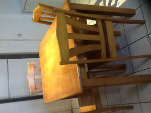 Four Solid wood chairs and dining table set
