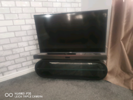 Black solid glass TV stand or coffee table