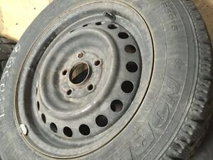 Two 195/65/15 Goodyear Nordic with rims