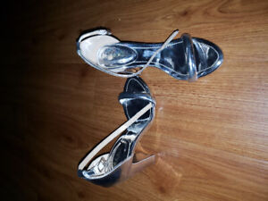 Silver Shoes, worn once, got as a gift but too high for me