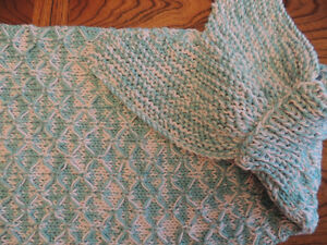 Hand knitted mermaid tail and shark tail blankets