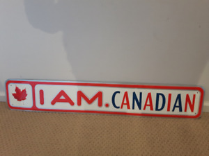 """""""I AM.CANADIAN"""" tin can sign (35"""" x 6"""")"""