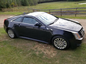 2012 black sporty Cadillac CTS coupe