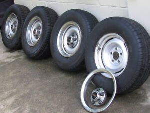 FOUR TIRES MOUNTED ON RIMS TWO SNOWS , TWO ALL SEASON, SIZE P235
