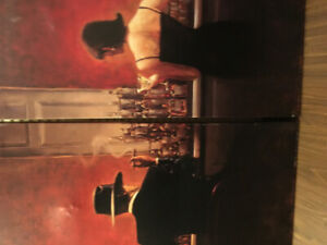 2 large  canvas pictures of man and woman in a 1940's lounge