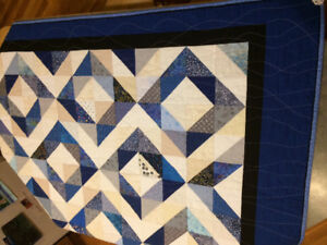 Blue scrappy diamonds quilt