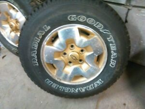 complete set for 4  like new tires and alloys from 1999 blazer