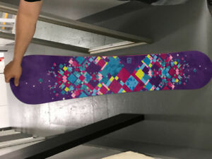 Snow board with binding never been used asking 400$
