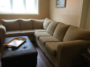 Large beige sectional with double bed