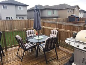 Glass Patio Table, 4 Chairs and Umbrella.