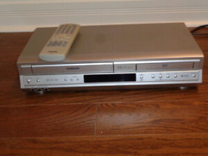 Two VCRs, 90 Movies and Storage Cabinet