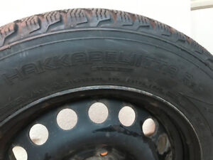Selling a set of 4 snow winter tires (NOKIAN) mounted on Steel