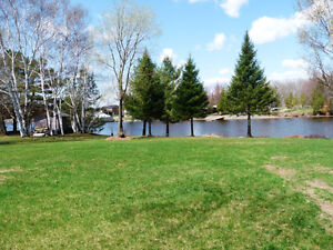 PRIME! PRIVATE 1 ACRE GORGEOUS WATERFRONT LOT!  EXECUTIVE HOME!
