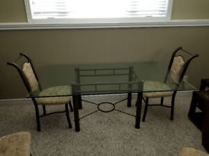 Glass top dining room table and chairs.  Hardly been used.