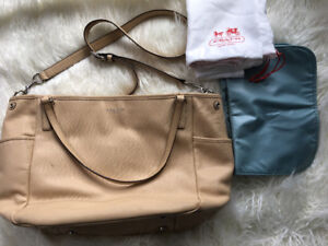 Coach, leather diaper bag with changing pad