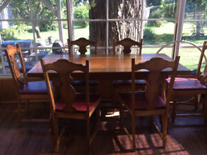 vintage danish wood table with 6 unique  chairs