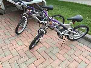 """Two 20"""" NEXT Dual Suspension Bikes"""