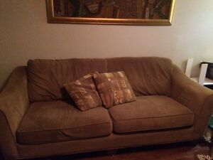 Couch with accent cushions.