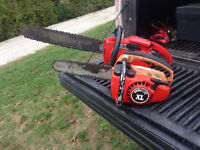4 chain saws and 1 weedeater