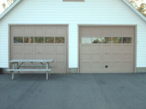 2 WOOD GARAGE DOORS     7 1/2 ft high by 9 ft wide