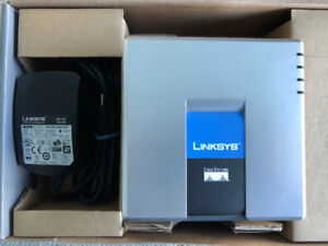 Unlocked Linksys/Cisco 2-line VOIP phone adapter SPA-2102