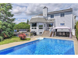 Stunning Backyard Oasis with pool-hot tub backing onto Park!