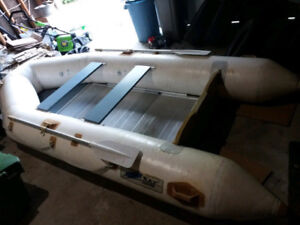 11.5 foot zodiac inflatable boat. width is 5.5 foot. seats 2 to