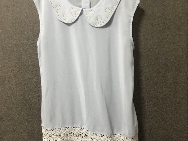 Periwinkle top with pearly collar and crotchet bottom