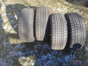 Four 215/55/16 Firestone winter force tires