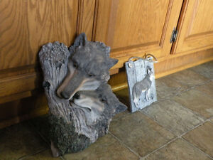 Two wolf wall sculptures