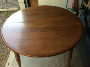 42 inch table with 2-21 inch leaves
