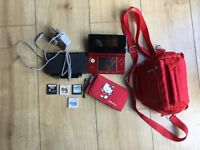 Red Nintendo 3DS with games