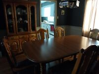 Dining room table, chairs and hutch