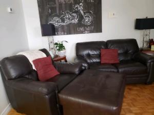 4 piece dark brown leather sofa set.