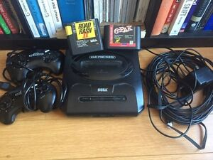 Sega Genesis with Controllers and Games