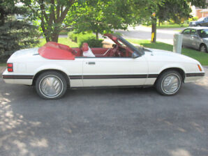 1983 Ford Mustang GLX Convertible 3.8L V-6 automatic.