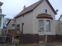 house/duplex for sale in young street, down town winnipeg