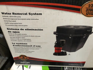 WATER REMOAVAL SYSTEM -AUTOMATIC SUBMERSABLE PUMP W BASIN $195