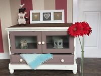 Relived painted TV unit