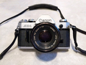 Canon AE-1 with Canon FD 50mm 1:1.8 lens and  case