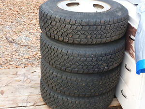 4 STUDDED SNOW TIRES ON RIMS 205/75R/14