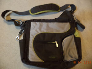 Diaper baby bag with a nursing pad
