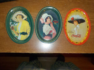 3 small coca cola tip trays