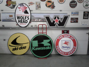 BIG SLED AND CYCLE SERVICE SIGNS