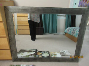 Large mirror and canvas wall art