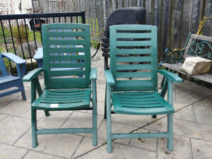 2 recliner plastic patio chairs.