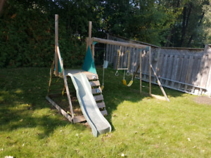 Children's swing set with slide and climber