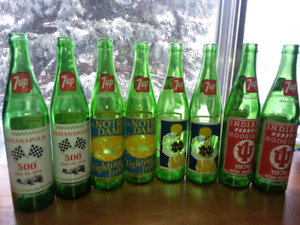 8 old collecror 7up bottles with vintage coke carrying case